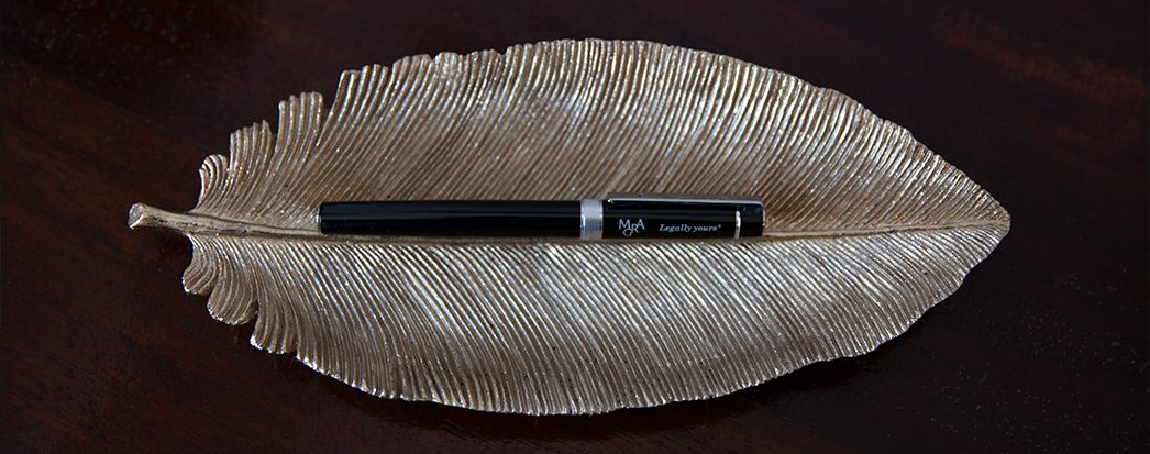 metal feather with a pen in the middle
